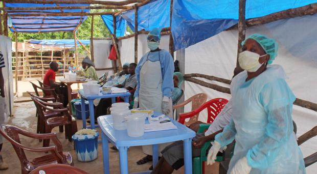 Medical personnel inside a clinic taking care of Ebola patients in the Kenema District on the outskirts of Kenema, Sierra Leone. (AP Photo/ Youssouf Bah)