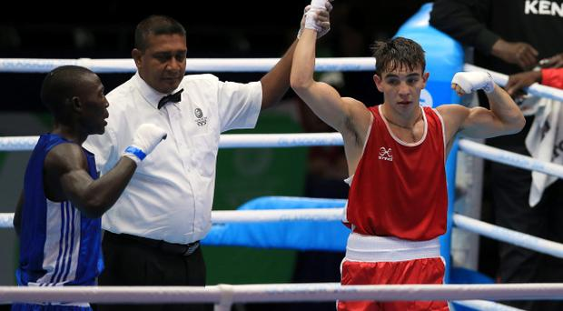 Michael Conlan (red) celebrates winning his match against Uganda's Bashir Nasir in Glasgow. Pic Peter Byrne/PA Wire