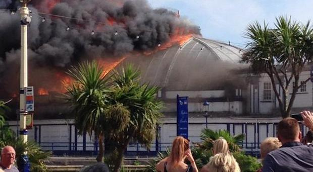A massive fire is currently ripping through the seaside destination of Eastbourne Pier. Pic Jake Garnell/PA Wire