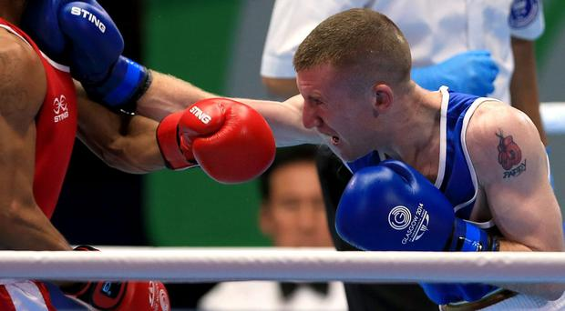 Northern Ireland's Paddy Barnes celebrates his victory against Papua New Guinea's Charles Keama. Pic Peter Byrne/PA Wire