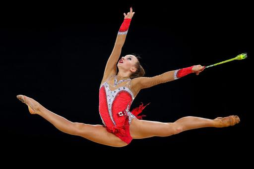 Patrica Bezzoubenko of Canada competes in the Clubs Rotation of the Individual All-Around Rhythmic Gymnastics at the SSE Hydro during day two of the Glasgow 2014 Commonwealth Games on July 25, 2014 in Glasgow, United Kingdom. (Photo by Paul Gilham/Getty Images)