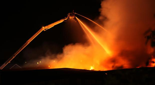Firefighters tackle a major blaze at a disused factory off the Clandeboye Road in Bangor. Photograph by Timothy Rooney