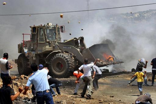 Caterpillar bulldozers at work in Gaza
