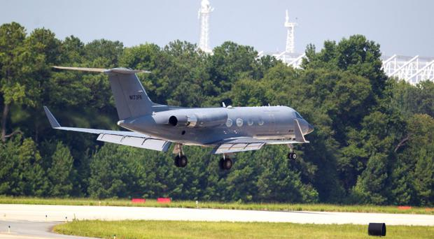 A private plane arrives at Dobbins Air Reserve Base transporting a second American missionary stricken with Ebola, Tuesday, Aug. 5, 2014, in Marietta, Ga. Nancy Writebol is expected to be admitted to Atlanta's Emory University Hospital on Tuesday, where she will join another U.S. aid worker, Dr. Kent Brantly, in a special isolation unit. (AP Photo/Todd Kirkland)