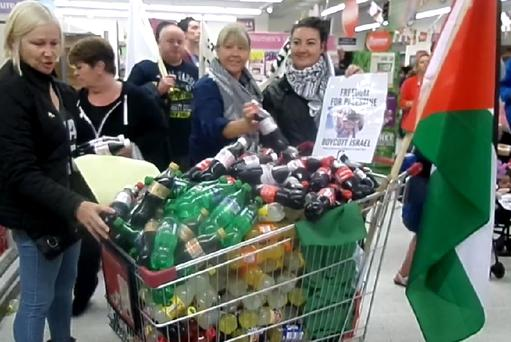 Crowds removed 'Israeli' goods from shelves of Sainsbury's in Belfast in protest over Gaza