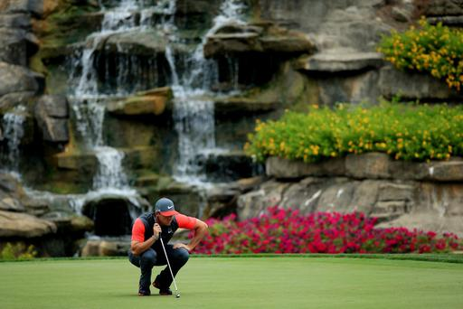 Rory McIlroy of Northern Ireland lines up his putt on the 13th green during the first round of the 96th PGA Championship at Valhalla Golf Club on August 7, 2014 in Louisville, Kentucky. (Photo by David Cannon/Getty Images)