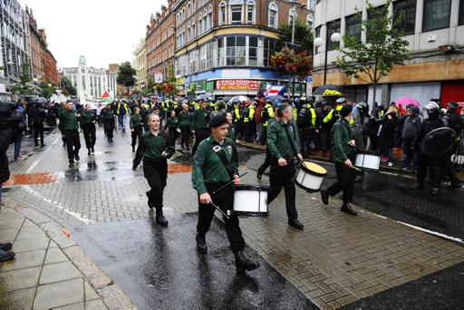 The republican anti-internment march passes by loyalist protesters on Royal Avenue in Belfast city centre. Pic Mark Marlow