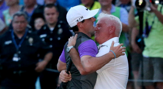Rory McIlroy of Northern Ireland celebrates victory with his father Gerry McIlroy