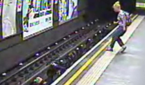 Shocking CCTV images showing the moment a child in a buggy on a London Underground platform was blown onto the track by a gust of wind