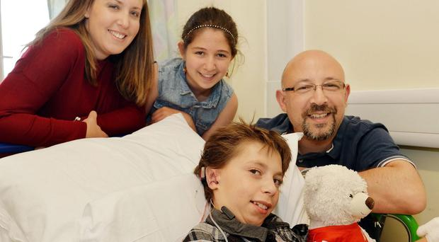 Kieran Sorkin, aged 9 (centre) from Watford in Hertfordshire, with his father David, mother Louise and sister Mia