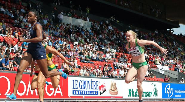 In a hurry: Amy Foster (right) qualifies for today's 100 metres semi-finals at the European Championships in Zurich yesterday