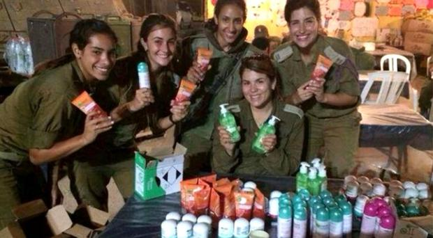 Photos of female Israeli soldiers posing with Garnier products were heavily criticised