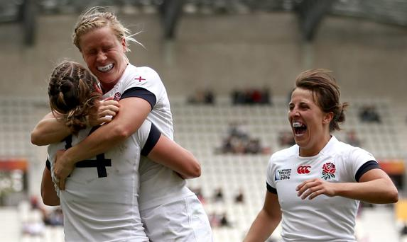 England's Katy Mclean (R) and Danielle Waterman of England (C) celebrate with Katherine Merchant of England (L) after she scores a try during against Ireland. Pic Jordan Mansfield