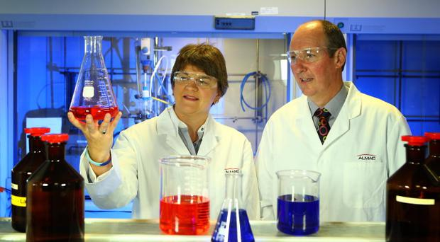 Pharmaceutical firm Almac is expanding its business over the next five years. Pictured with Enterprise Minister Arlene Foster is Alan Armstrong, Chairman and CEO, Almac Group.