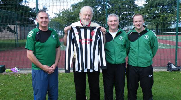 Jim 'Chick' Wilson (assistant coach), Roy Finlay, Willie Walker (assistant manager), James Fawcett (goalkeeping coach) with the new Holywood home shirt