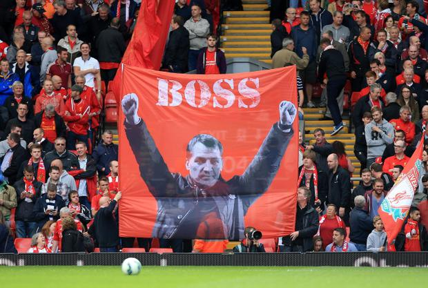 Liverpool fans display a banner of