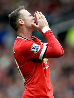 Same old story: United's new captain Wayne Rooney shows his despair during Saturday's home match against Swansea