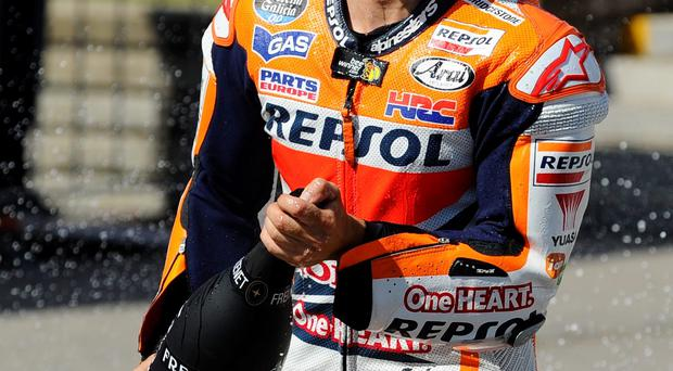 Champ: Dani Pedrosa celebrates after winning yesterday