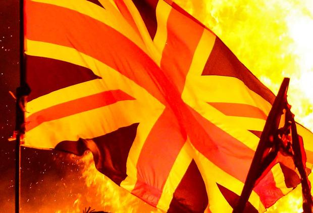 Alliance slams burning of Union flags at bonfire in Londonderry