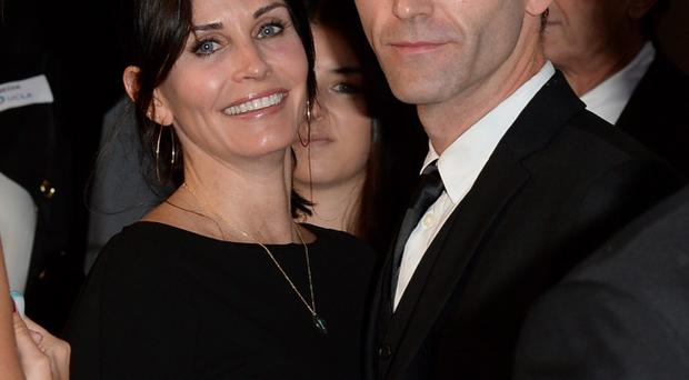 Snow Patrol's Johnny McDaid is said to be struggling to choose between two of his closest friends to decide who will do the honours at his wedding with Courteney Cox