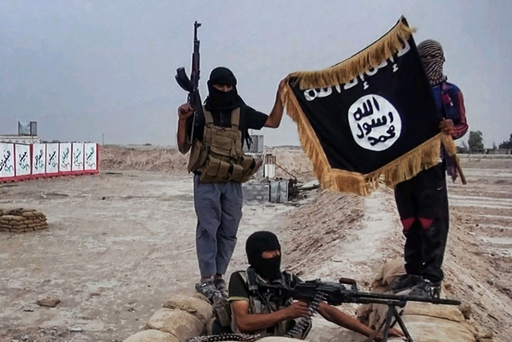 Islamic State rebels show their flag after seizing an army post
