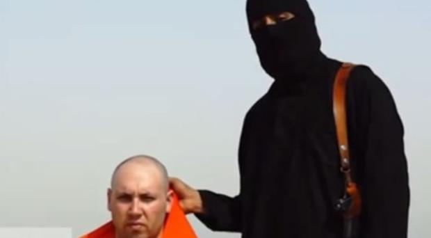 The militant with a man thought to be the journalist Steven Sotloff