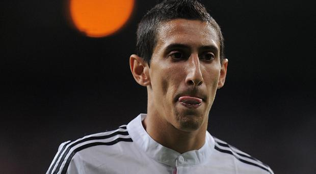 MADRID, SPAIN - AUGUST 19: Angel di Maria looks on during the Supercopa first leg match between Real Madrid and Club Atletico de Madrid at Estadio Santiago Bernabeu on August 19, 2014 in Madrid, Spain. (Photo by Denis Doyle/Getty Images)