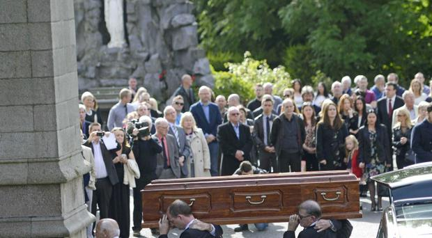 Family and friends carry the coffin during the Funeral of veteran Broadcaster Gerry Anderson at St Eugene's Cathedral in Derry on Sunday Photo Colm Lenaghan/Pacemaker Press