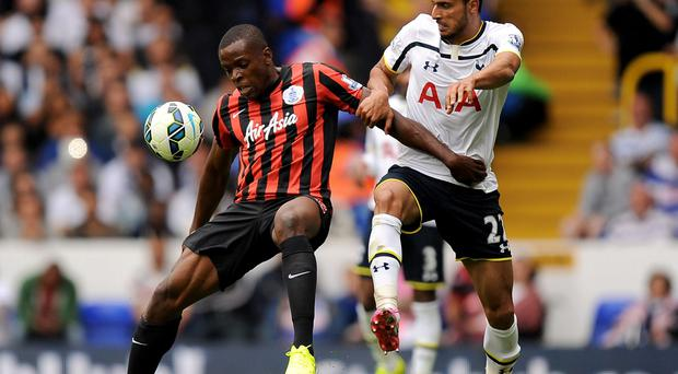 Queens Park Rangers' Nedum Onuoha battles for the ball with Tottenham Hotspur's Nacer Chadli during the Barclays Premier League match at White Hart Lane, London. Andrew Matthews/PA Wire.