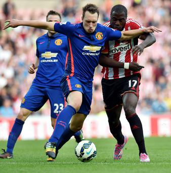 Manchester United's Phil Jones and Sunderland's Jozy Altidore (right) in action during the Barclays Premier League match at the Stadium of Light, Sunderland. Owen Humphreys/PA Wire.