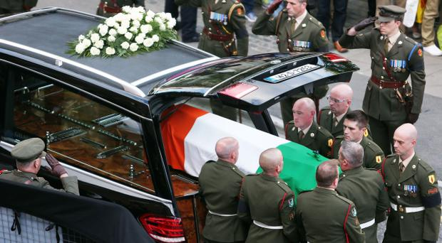 The coffin containing the remains of former Taoiseach Albert Reynolds is removed from Mansion House, Dublin, after lying in state prior to his funeral on Monday. Brian Lawless/PA Wire