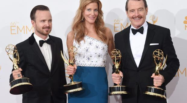 Breaking Bad actors Aaron Paul, Anna Gunn and Bryan Cranston at the 66th Annual Primetime Emmy Awards in Los Angeles, California (Photo by Jason Merritt/Getty Images)