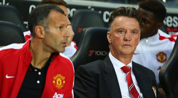Manager Louis van Gaal of Manchester United looks on with assistant Ryan Giggs at the Capital One Cup Second Round match between MK Dons and Manchester United at Stadium mk on August 26, 2014 in Milton Keynes, England. (Photo by Clive Mason/Getty Images)