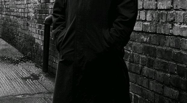 Jimmy Nesbitt, the relentless RUC detective who hunted some of the most evil killers of the Troubles, photographed by Bobbie Hanvey in a grim alley near Tennent Street police station where the Shankill Butchers dumped a number of their victims