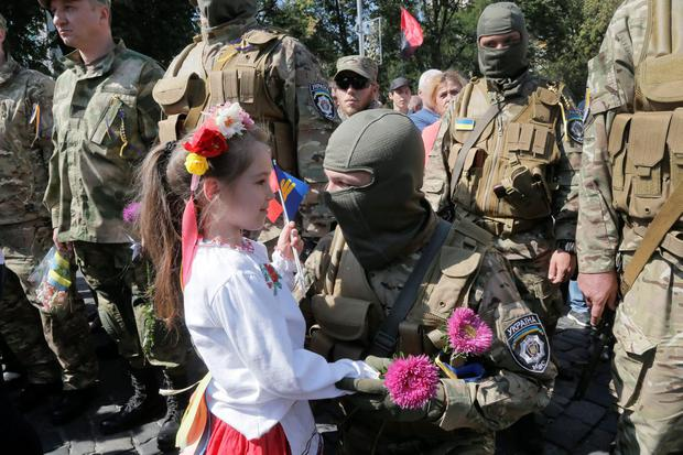 Relatives and friends say goodbye to volunteers before they were sent to the eastern part of Ukraine to join the ranks of special battalion unit fighting against pro-Russian separatists, in Kiev, Ukraine, Tuesday, Aug. 26, 2014. (AP Photo/Efrem Lukatsky)