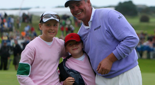 That's my boys: Darren Clarke celebrates his win in the KLM Open in 2008 with sons Tyrone (left) and Conor