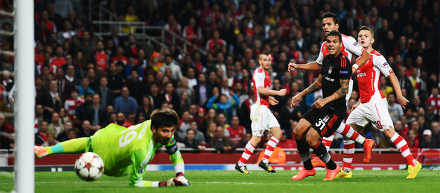 Money shot: Alexis Sanchez (third right) beats Besiktas goalkeeper Tolga Zengin for the goal that secured Arsenal's place in the Champions League group stages