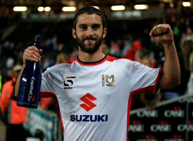 Milton Keynes Dons goalscorer Will Grigg with the man of the match award