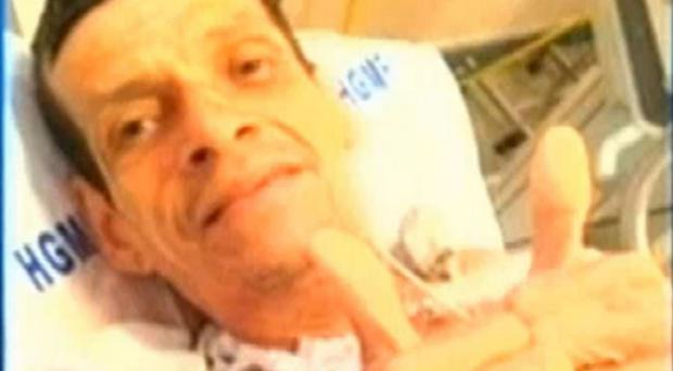 Valdelucio Goncalves was taken back to the hospital for treatment and was then photographed alive, both thumbs up.