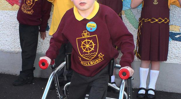 Oliver Dickey with his classmates on his first day back at Millburn Primary School yesterday