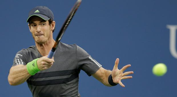 Andy Murray, of Britain, returns a shot to Matthias Bachinger, of Germany, during the second round of the 2014 U.S. Open tennis tournament Thursday, Aug. 28, 2014, in New York. (AP Photo/Darron Cummings)