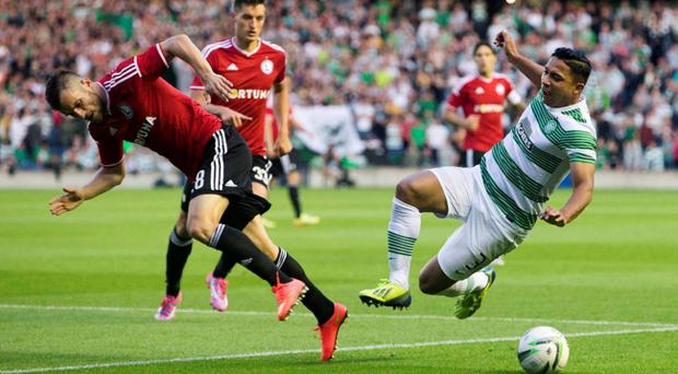 Celtic's Emilio Izaguirre (right) and Legia Warsaw's Lukasz Broz battle for the ball during the Champions League Qualifying at Murrayfield, Edinburgh.