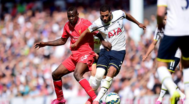 Tottenham Hotspur's Etienne Capoue (right) and Liverpool's Mario Balotelli battle for the ball during the Barclays Premier League match at White Hart Lane, London. Adam Davy/PA Wire.