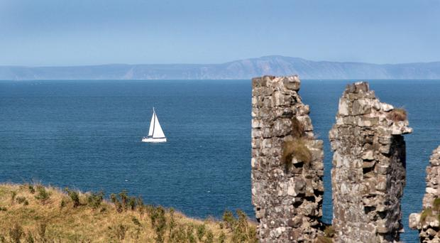 The cliffs of Scotland seen from Dunseverick Castle in Co Antrim