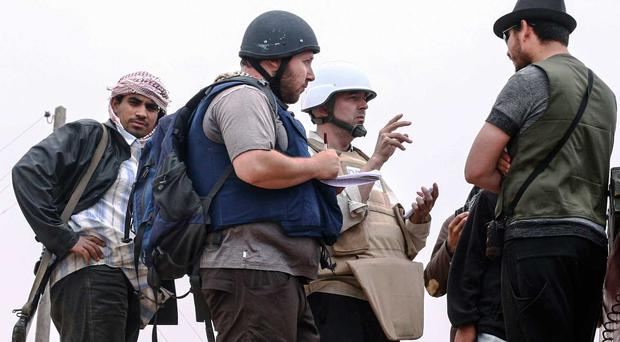 Journalist Steven Sotloff, left, pictured in Libya in 2011 (Getty)