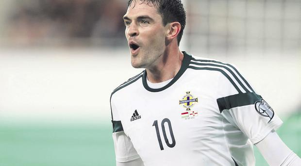 Laff out loud: a delighted Kyle Lafferty enjoys the moment after scoring what turned out to be the winner for Northern Ireland against Hungary last night