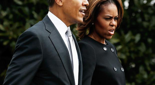 Cool customer: Barack Obama, seen here with First Lady Michelle, is calm in a crisis