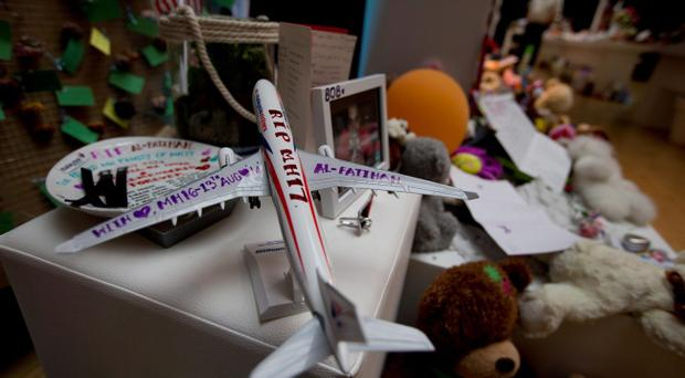 A Malaysia Airlines miniature plane with a text reading