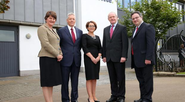 First Minister Peter Robinson and deputy First Minister Martin McGuinness are pictured with jobs minister Arlene Foster, Employment Minister Dr Stephen Farry and Jackie Henry of Deloitte. Pic Kelvin Boyes/Press Eye
