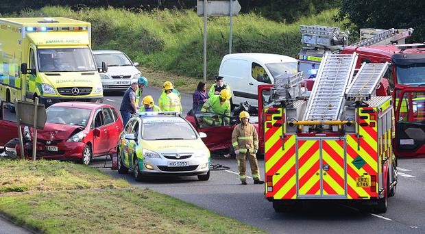 The scene of a road crash accident on the Belvoir Road in Belfast. Pic Arthur Allison